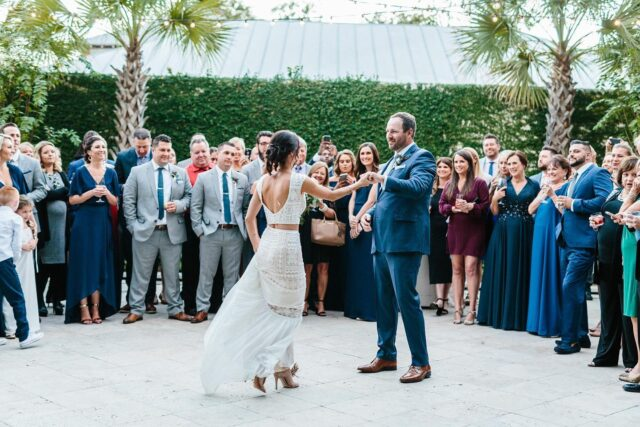 """I love when couples decide they are going to change it up and do things different at their weddings. THIS ONE was magical taking place in Charleston, South Carolina a few years ago and Jessica + Tanner planned one to remember. Here are a few reasons why this wedding stands out to me:  -FIRST DANCE-They did their first dance in the court yard at the end of cocktail hour. Their friends and family were surrounding them creating a really memorable experience. I still remember the song because it was that memorable- """"This Too Shall Last"""" by Anderson East. Inviting guests into the experience instead of having them just watching from their seats is a whole different experience.  -LIVE BAND- this changes everything in my opinion. Live music with real instruments and people signing is a whole different experience than DJ. I'm not opposed to a DJ but what I love  with live bands is the experience as a whole throughout the reception. They lead the whole night with humor and spunk. Nothing else beats the fun, the dancing, and engagement that  live music offers, especially at weddings.  -DONUT WALL- Yes they did have a wedding cake but they also had a donut wall!!! I mean who isn't excited about donuts?! It was a cute and unique thing I had never seen at a wedding!!  -DINNER-I'm obsessed with how they did dinner. There were 4 stations in different parts of the room with all different types of food. One had asian flavors, one steak and fries, one had tacos, and another had veggies. I'm a food so I was obsessed with this idea.   Whatever you decide for your reception know you don't have to do it the way it's always been done. You can change it up!!! Actually, I want you to change it up. Still keep your traditions that actually mean something to you but change what doesn't mean anything to you. Let us plan our weddings with intention not just copying what is """"suppose"""" to happen. MANY MORE stories on this later this week on couples changing up their versions of weddings.   Venue + C"""