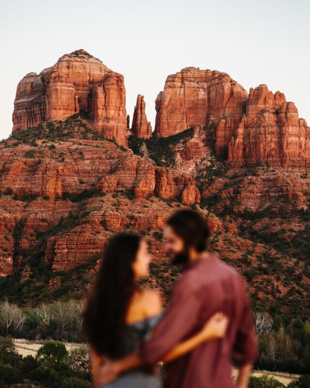 """I had NO IDEA when I moved to Arizona the gold that was just around the corner. 🌵🏜🏔☀️ This state, it's diverse. It comes with many different colors, textures, and elevations.  Every single day I drive down to Sedona I feel at peace. I get it why people come here from all over the world to rest and relax. It doesn't feel like I'm """"doing work"""" when I shoot there, it feels like I'm playing and creating magic with the rocks and sunshine.  I know that sounds super hippie dippy but it's true.   Ryan and Corrine's session was one for the books! My dear friends who live on Big Island are also wedding / elopement photographers and killing the game. @alohazoephotography I'm so happy I was able to photograph their engagement session years and years ago.  :)"""